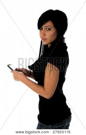 Teenage girl using a cell phone to send a text message on a cell phone