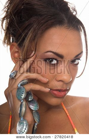 Beautiful African American woman in a yellow tropical bikini holding a blue Abalone shell necklace laced through her fingers