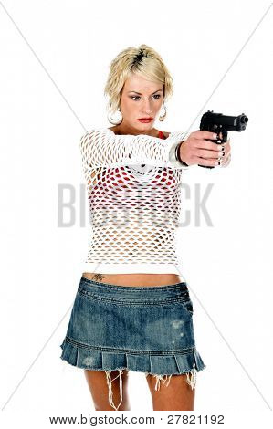 Sexy OC blonde fashion diva in a denim skirt, net top and red bra with a 45 caliber handgun pointed at the camera. Selective depth of field isolated over white.