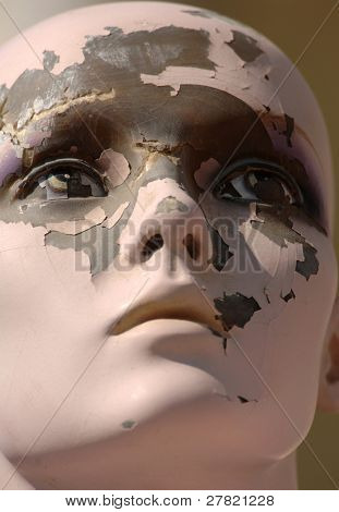 Deteriorating face of a once regal mannequin