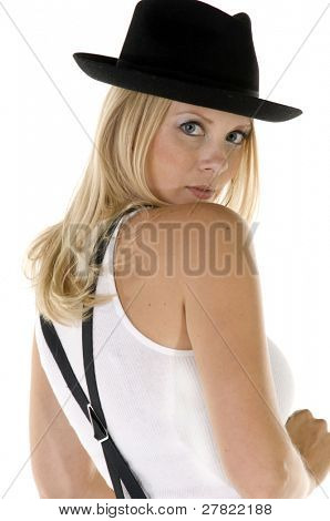 Sassy blonde woman in retro clothing reminiscent of 1940's menswear looking back over her shoulder