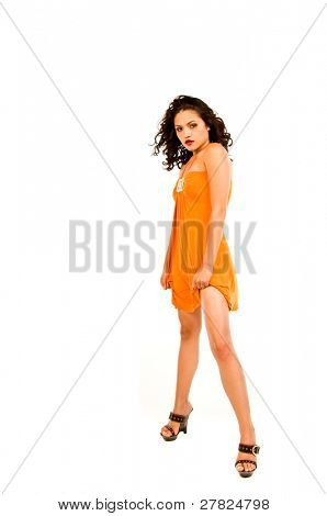 Beautiful multi ethnic woman of Spanish and Native American descent wearing an orange dress
