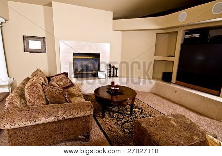 Master Bedroom sitting room with fireplace, big screen TV and over stuffed furniture