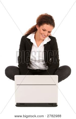 Businesswoman Sitting With Laptop