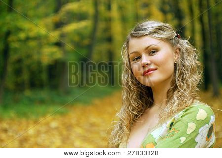 romantic girl in an autumn wood
