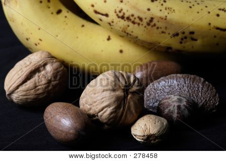 Mixed Nuts Beside Bananas