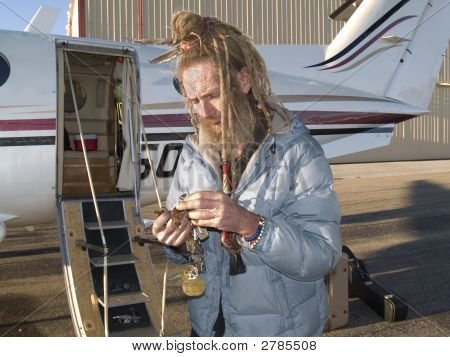 Eccentric Older Man Looking For A Key For His Aircraft