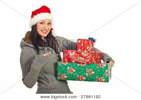 Happy Woman Pointing To Her Xmas Gifts