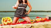 Woman In Retro Dress Having Picnic Near Sea poster