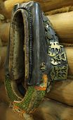 Old Horse Yoke With Brass Ornaments And Paintings On Barn Wall poster