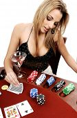 A sexy young blond playing Texas Holdum Poker Card backs are a digitally created design