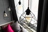 Loft Style Iron Lampshade With A Light Bulb In The Interior Living Room In Modern Apartment. Vintage poster