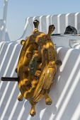Wooden Ships Steering Wheel. The Yachts Steering Wheel. The Yachts Steering Wheel Sails On The Sea.  poster