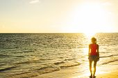 Girl Silhouette Looking Beach Sunset Standing. Ocean Sunset. Tropical Beach. Travel Concept. Girl Lo poster
