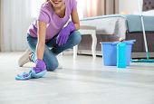 Young Woman Washing Floor With Rag And Detergent In Bedroom, Closeup. Cleaning Service poster