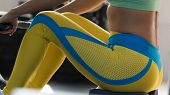 Close-up - Sporty Woman Working Out On Rowing Machine. Strong Female During Intense Cardio Workout I poster