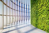 Office building with large panoramic windows and vertical green garden. 3D illustration. poster