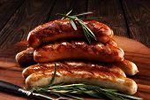 Grilled Sausages With Spices On A Wooden Table - Home-made Pork Sausages poster