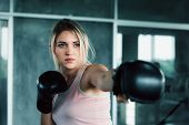 Female Boxer Is Training Punching In Fitness Gym.,portrait Of Boxing Woman Is Practicing Footwork In poster