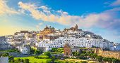 Ostuni White Town Skyline At Sunset, Brindisi, Apulia Southern Italy. Europe. poster