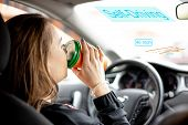A Young Woman Rides In Car With Autonomous Driving Mode And Drinks Coffee. Self Driving Technology. poster