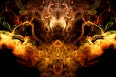 Thick Colorful Smoke Of Yellow And Orange  In The Form Of A Skull, Monster, Dragon On A Black Isolat poster