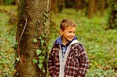 Funny And Cute. Funny Kid. Small Kid Play In Woods. Small Boy Have Fun Outdoor. Being Funny I Can Ma poster