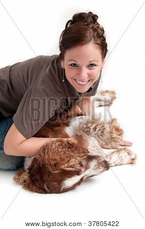 young lady playing with dog