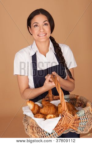 Happy Woman Carrying Fresh Croissants