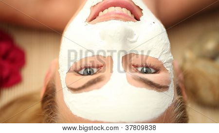 Smiling Woman In A Facemask