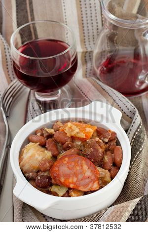 Sausages And Beans Stew With Glass Of Wine