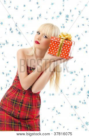 Beautiful Blonde Woman With Christmas Gift. Snow Flakes