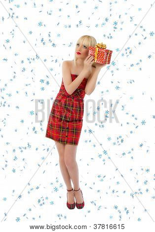 Pretty Woman In Red Dress With Christmas Gift. Snowflakes