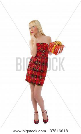 Blonde Model Posing In Red With Gift