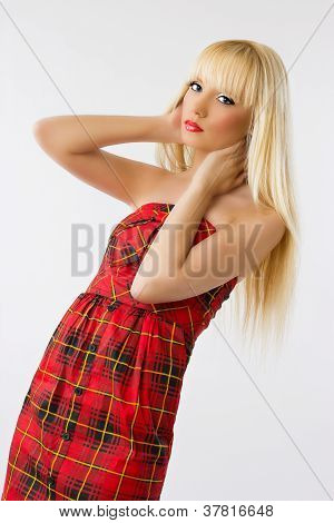Woman In Red Dress With Long Blonde Hair