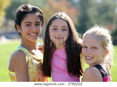 Three Smiling Girls