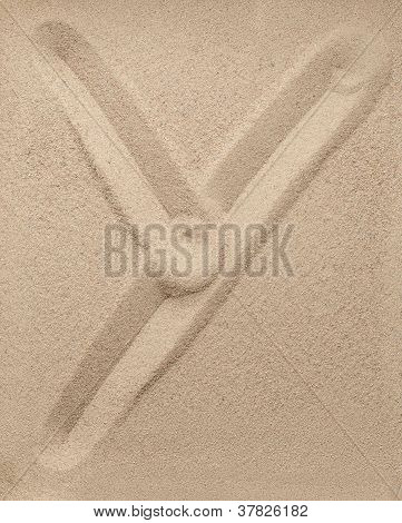 Letter Y from sand