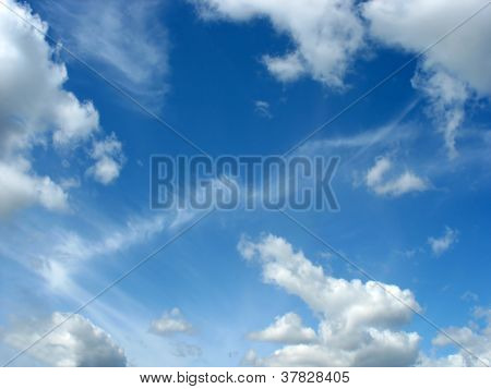 Blue sky with fleecy and cumulus clouds