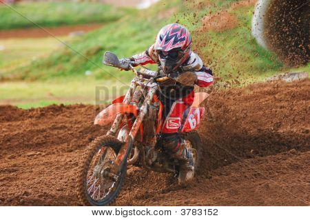 Motocross Rider Powering Out Of A Corner