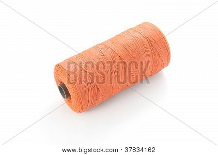 Red plastic spun roll on white background.
