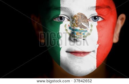 Portrait of a child with a painted Mexican flag