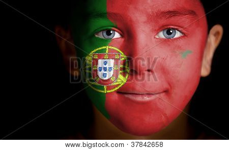 Portrait of a child with a painted  Portuguese flag