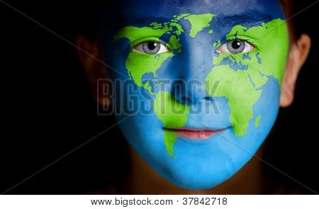 Portrait of a child with a painted world map