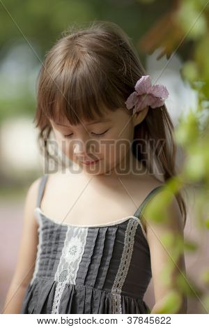 young girl flower in her hair