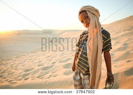 Tunisian boy in Sahara