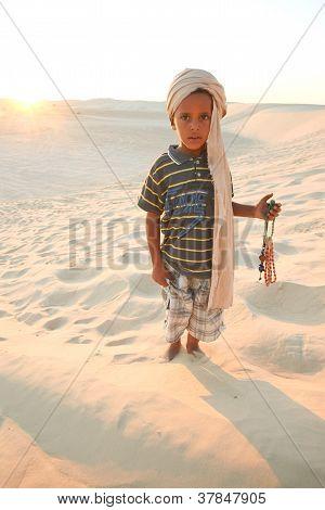 Tunisian boy in the desert