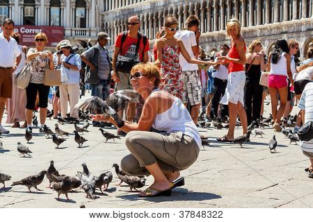 16. Jul 2012 - People With Pigeons In San Marco Plaza 3 In Venice, Italy