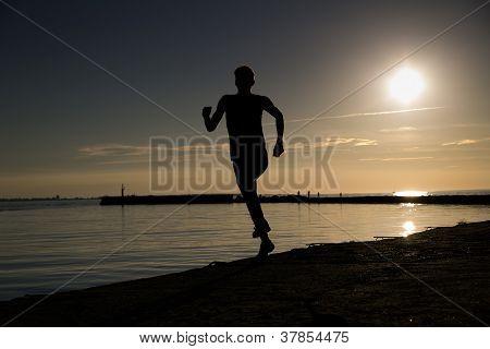 Sportsman Making Jumpy Movement At Beach Evening