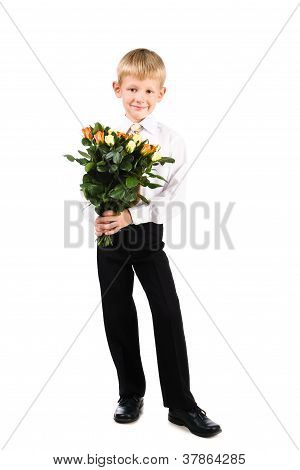 Full Lenght Portrait Of Cute Boy 5-7 Years Old Holding Roses Isolated Over White Background