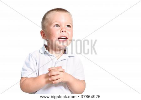 Portrait Of Excited Little Boy Looking Aside Isolated Over White